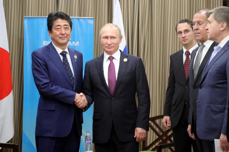 Putin links Japan peace treaty to Tokyo's alliances