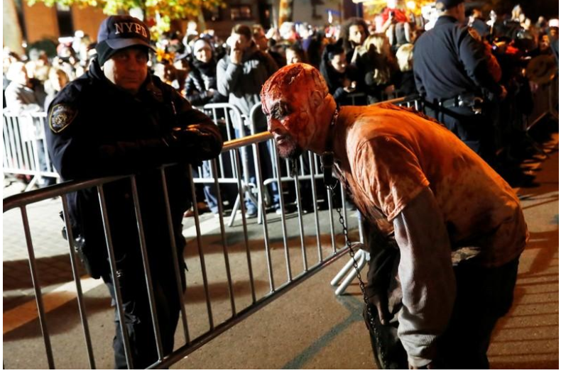 Exuberant and defiant, New Yorkers flock to Halloween parade despite attack