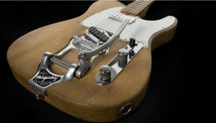 A Bob Dylan guitar fetches $495,000 at auction