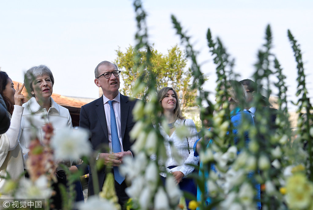 Theresa May visits the RHS Chelsea Flower Show in London