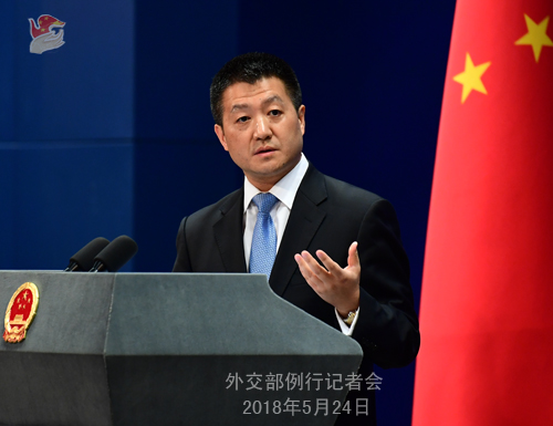 China says attempts at coercion on South China Sea issue futile
