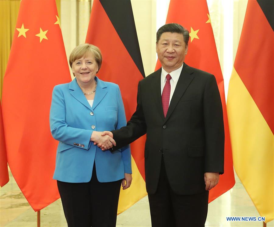 Xi and Merkel pledge more trade deals and closer contact on hot-spot issues