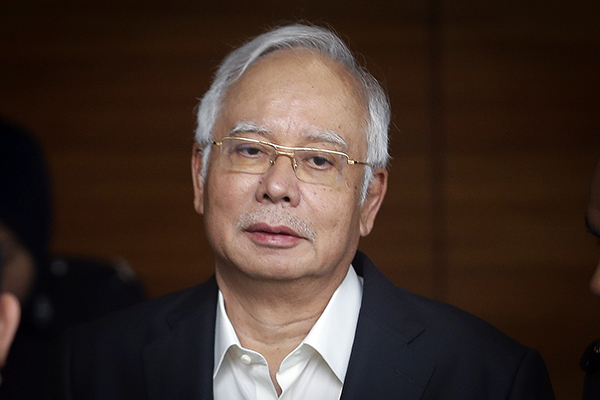Large amount of cash seized from apartments linked to former Malaysian PM Najib: police