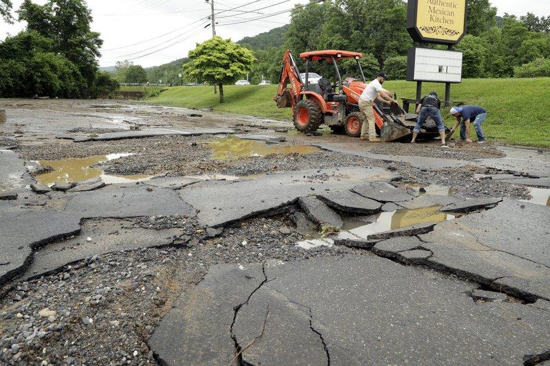 Soggy Alberto triggers mudslides, threatened dam is OK