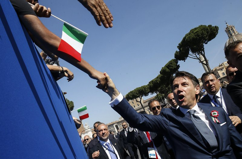 New Italian govt vows to create jobs, deport migrants
