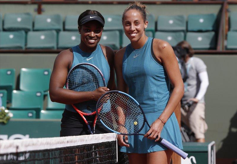 Halep beats Muguruza, Stephens tops Keys at French Open
