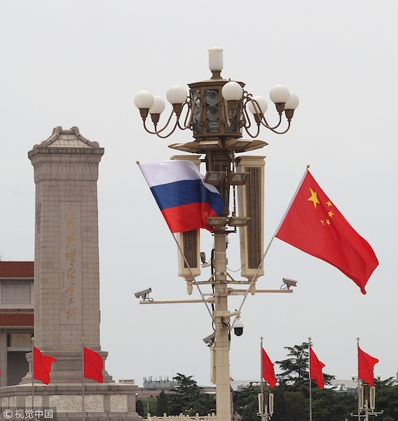 China, Russia agree on promoting ties for greater development