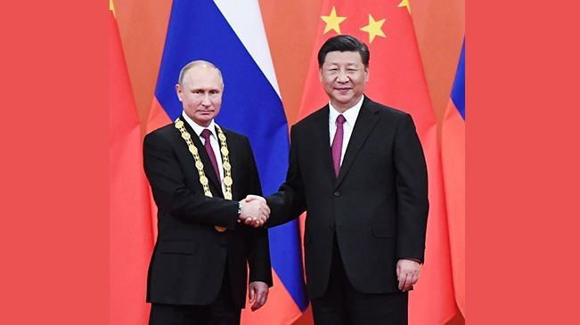 Presidents of China, Russia talk on ties over phone