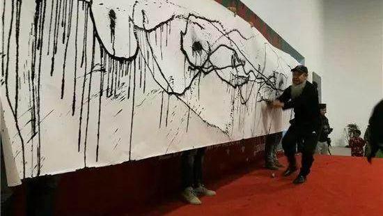 Avant-garde art of graffiti? Chinese calligrapher turns syringes into brushes