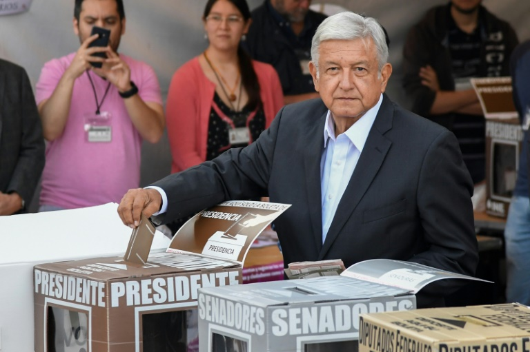 Leftist 'AMLO' favorite as Mexico vote opens
