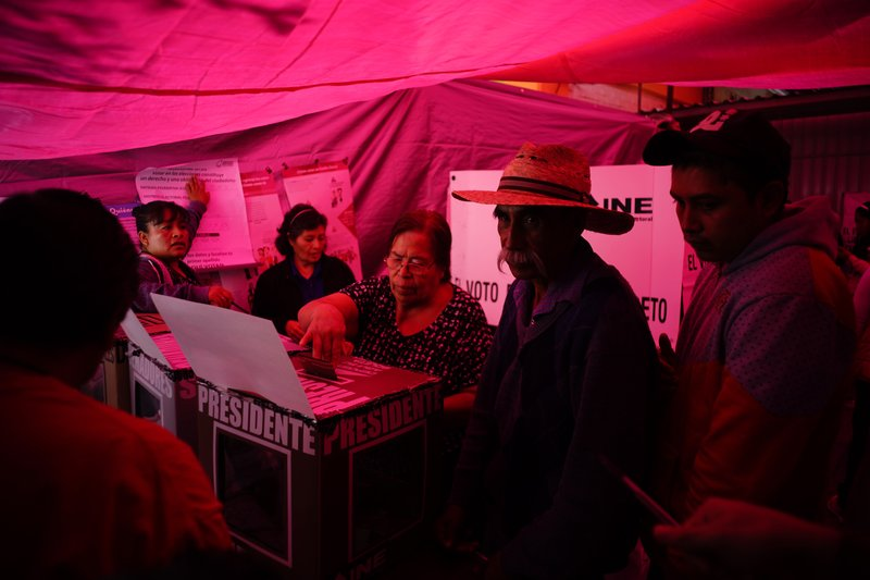 Weary of violence, graft, Mexicans vote in historic election