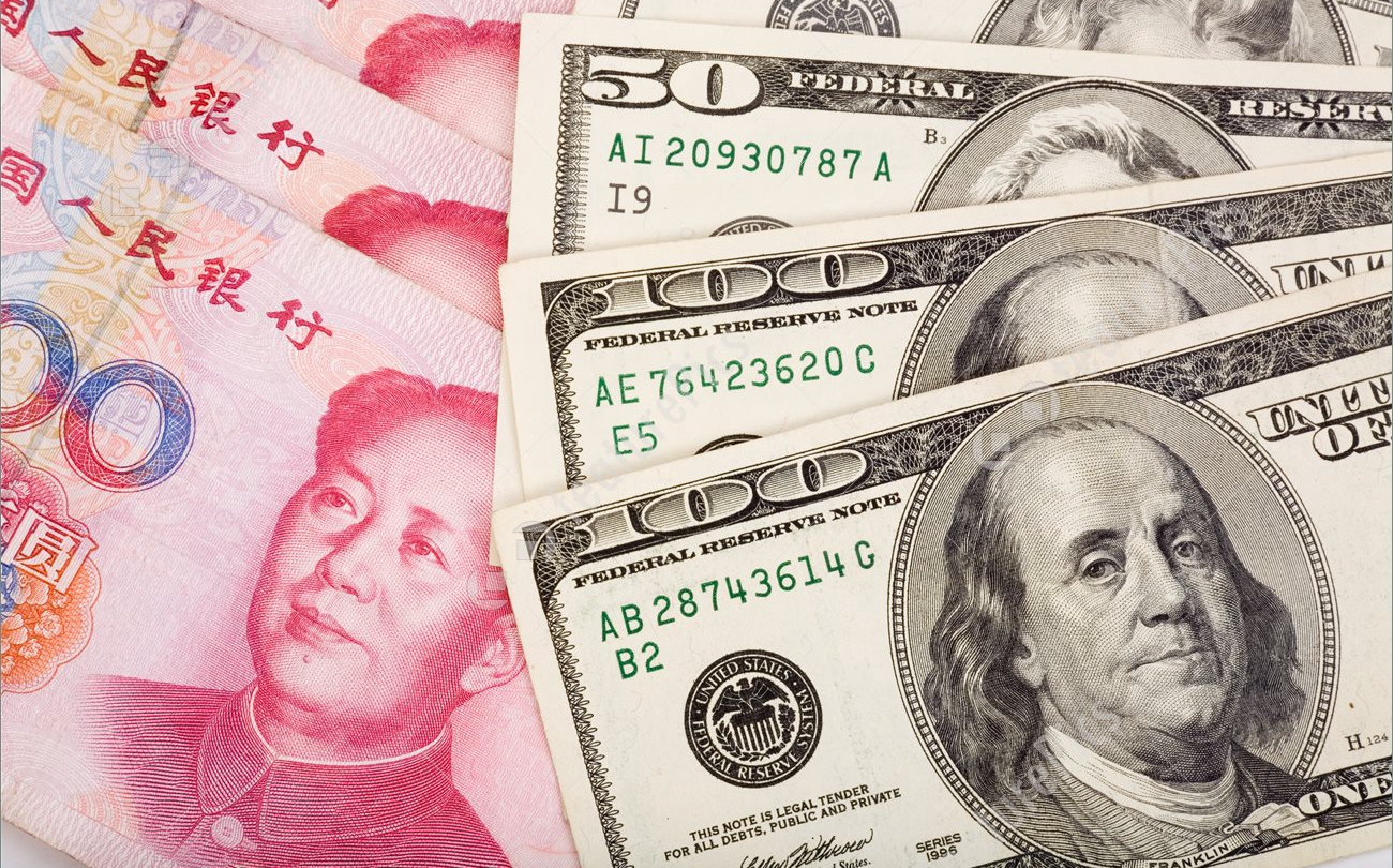 chinese-yuan-and-us-dollar-stock-photo-465811.jpg