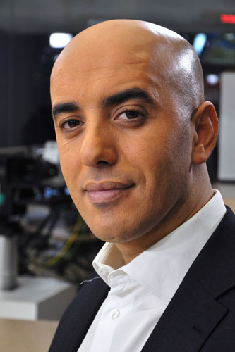 In this photo dated Nov. 22, 2010, notorious French criminal Redoine Faid poses prior to an interview with French all-news TV channel, LCI, as he was promoting his book, in Boulogne-Billancourt, outside Paris, France. Faid serving 25 years for murder made an audacious escape from prison Sunday after a helicopter carrying several heavily armed commandos landed in a courtyard, freed him from a visiting room and carried him away. [File photo: IBO/Sipa via AP]
