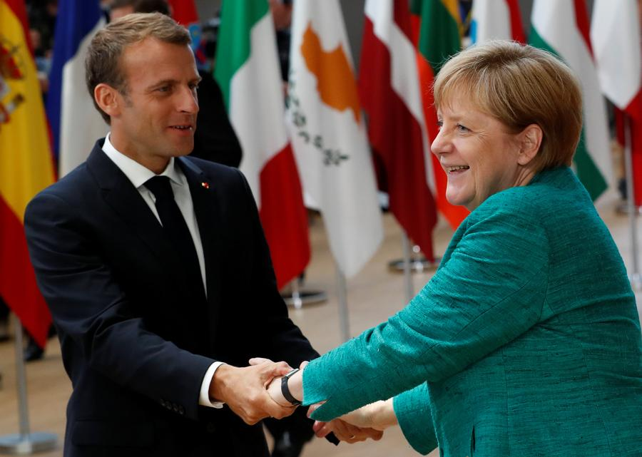 EU immigration deal papers over Merkel's domestic weakness, Italy' new obstinacy