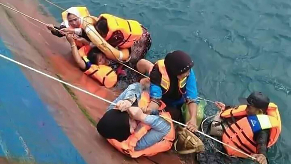 Indonesia says at least 34 died in ferry sinking, search for survivors continues