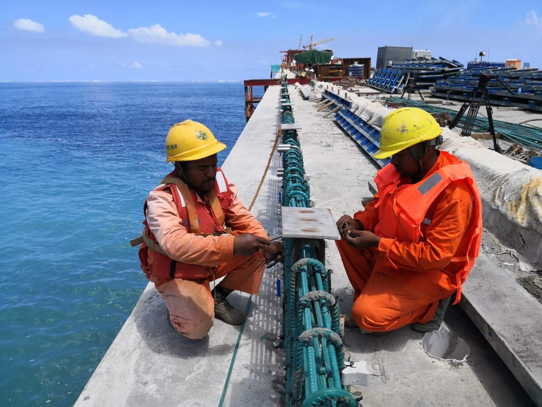 Workers on the China-Maldives Friendship Bridge, July 9, 2018. [Photo: China Plus/Yang Tianshu]