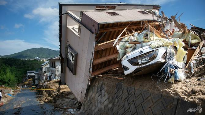 record-floods-in-japan-have-killed-more-than-100-people-as-authorities-warn-about-the-risk-of-landslides--1531136012183-6.jpg