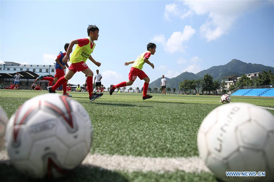 Young players receive trainings during football summer camp in SW China's Guizhou