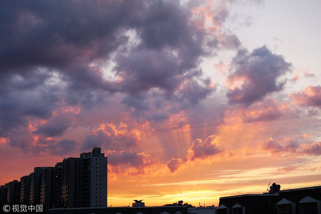 Post-typhoon Beijing basks in sunset glow