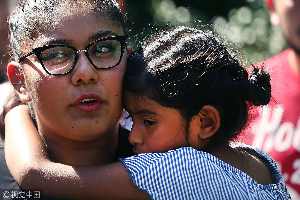 The emotional scene as migrant families are reunited in the US