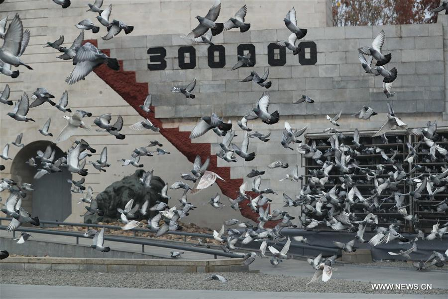 Photo taken on December 13, 2017 shows doves flying on China's National Memorial Day for Nanjing Massacre Victims at the memorial in Nanjing, Jiangsu Province. [File photo: Xinhua]