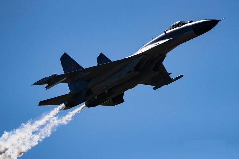 J-11B fighter jet conducts tactical maneuver