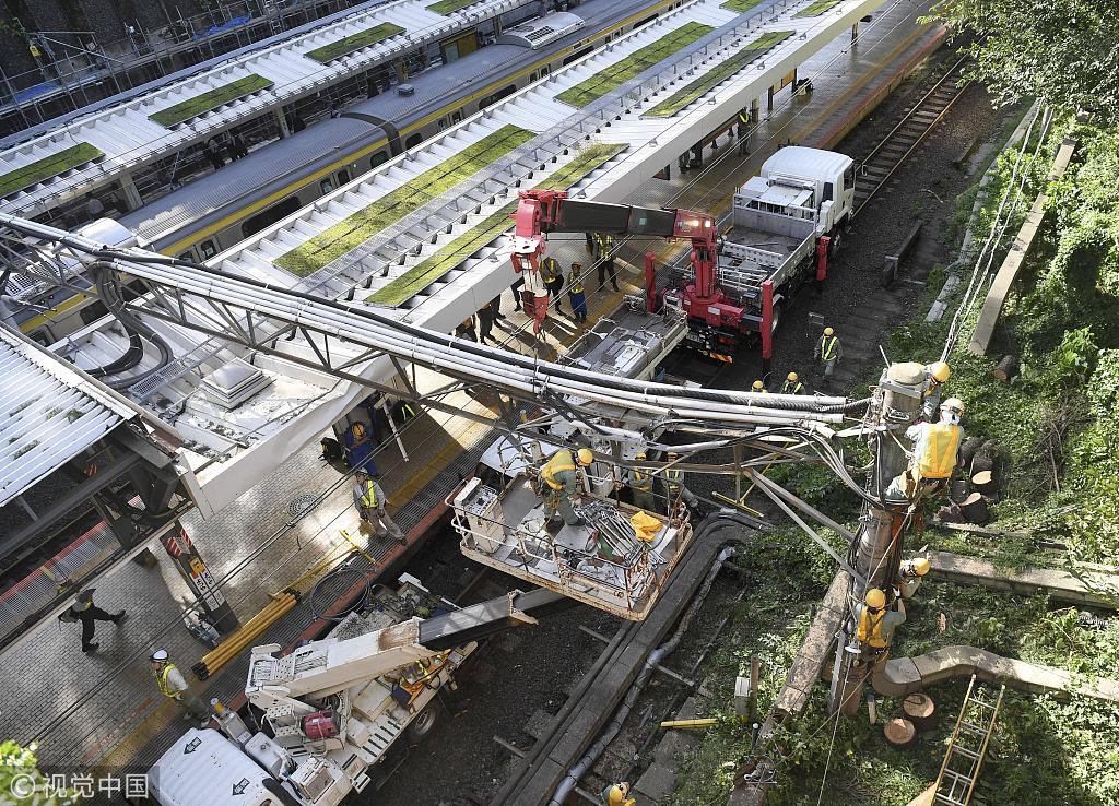 Two dead after typhoon batters Japan