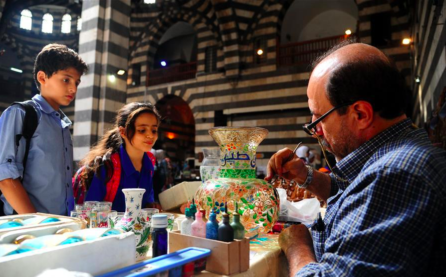 People visit traditional handicrafts exhibition in Damascus, Syria