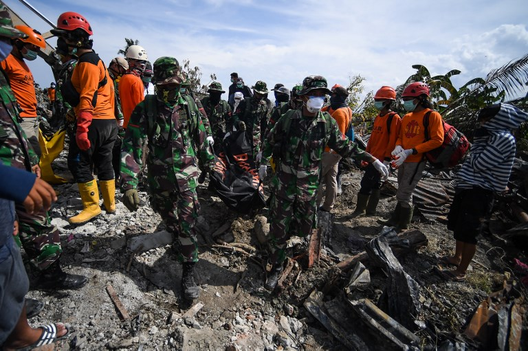 Disease fears as more bodies found in Indonesia disaster