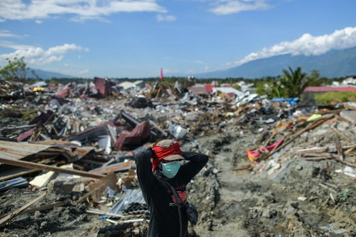 More bodies found as death toll from Indonesia quake nears 2000
