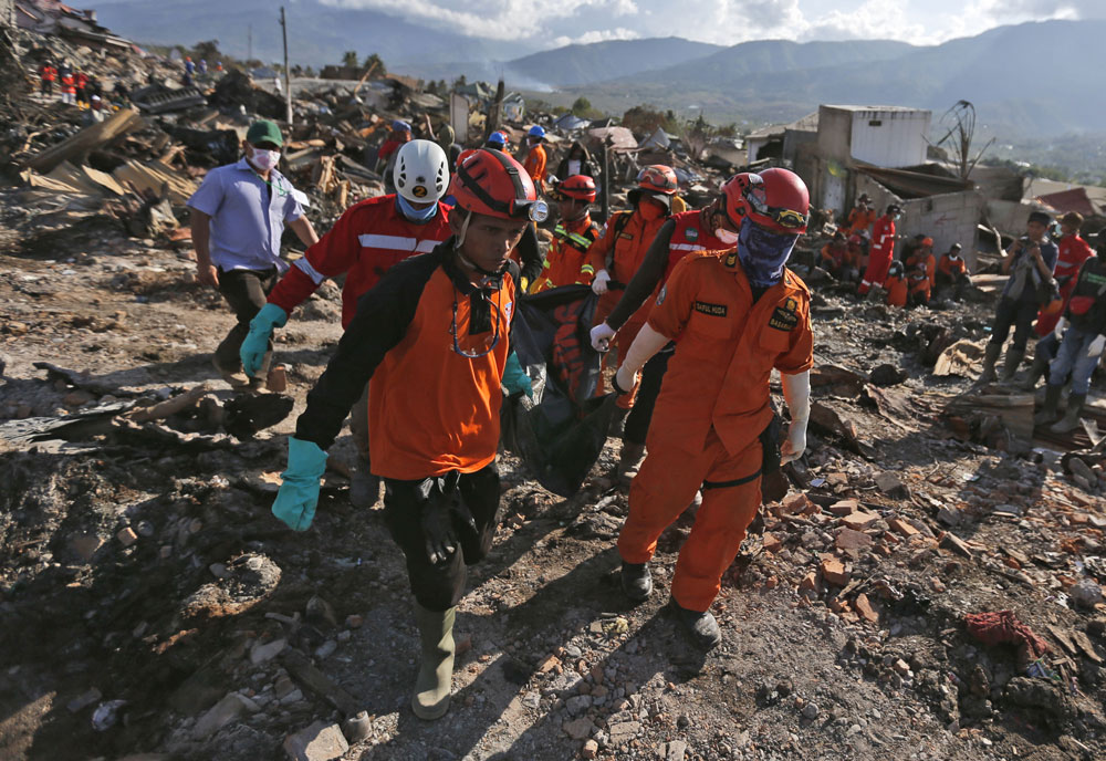 1,948 die from Indonesia's quakes, tsunami, over 5,000 missing