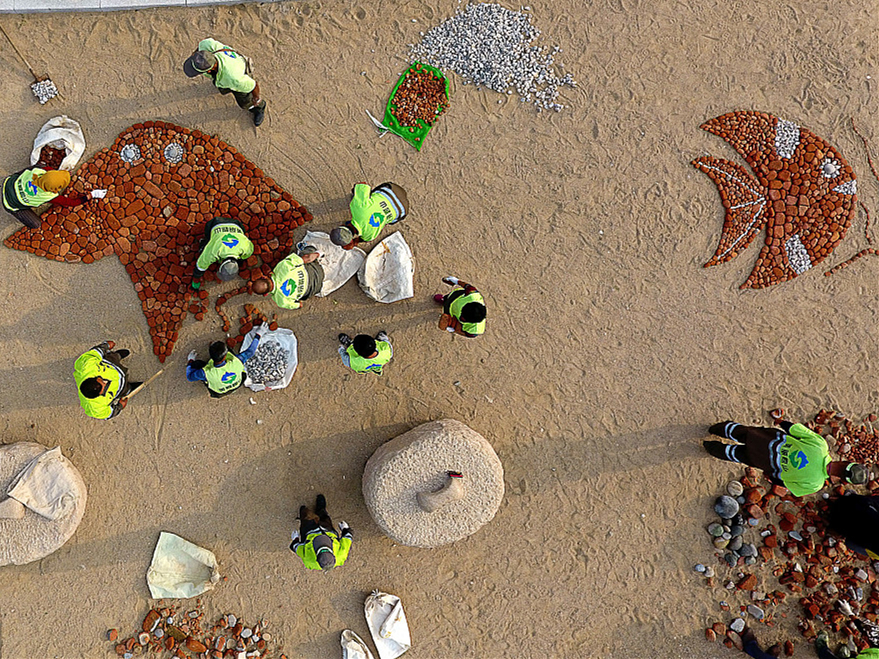 Turning trash into art: Sanitation workers beautify beaches with creative art