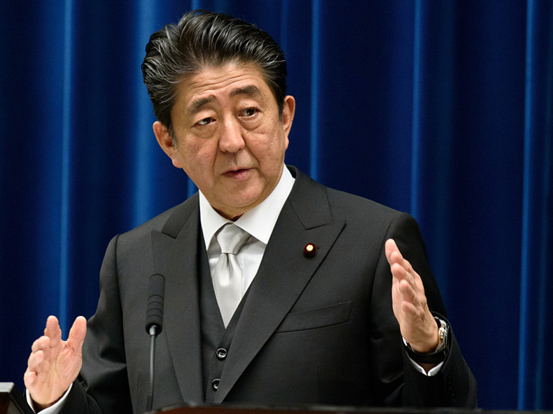 Japan's Abe confirms consumption tax hike to go ahead as planned next year