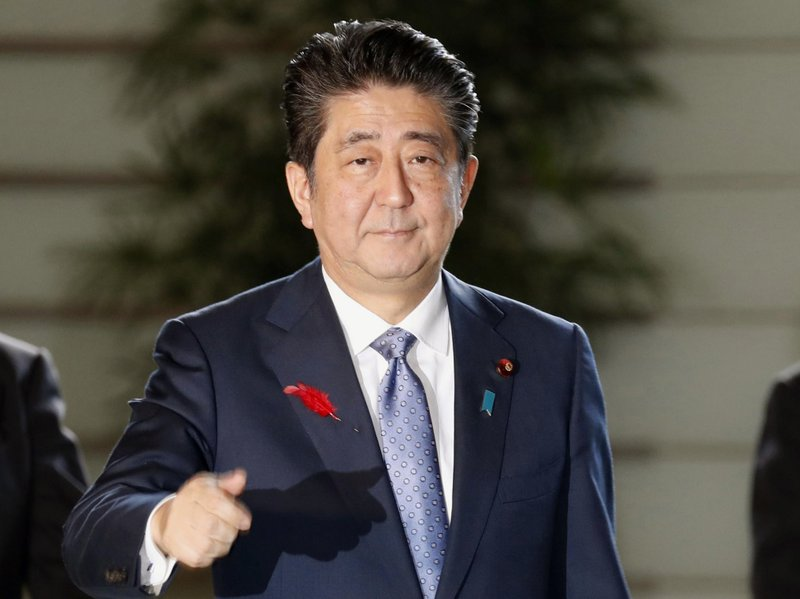 Japan's Abe confirms consumption tax hike to go ahead as planned