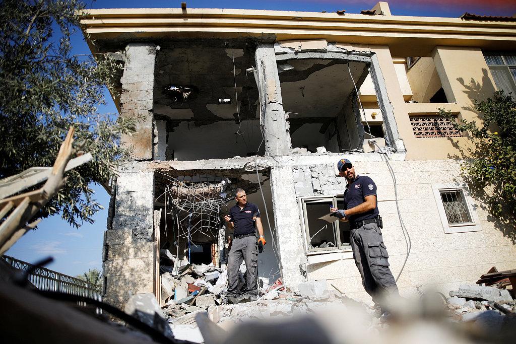 Gaza rocket hits home in Israel, military strikes back