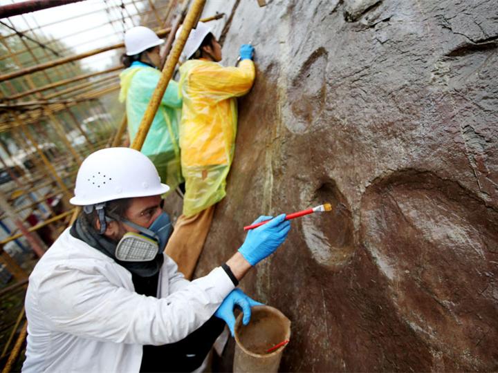 Dinosaur footprints in Beijing receive protective coating