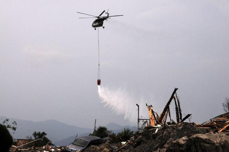 Disinfectant dropped on Indonesia's quake, tsunami hit areas