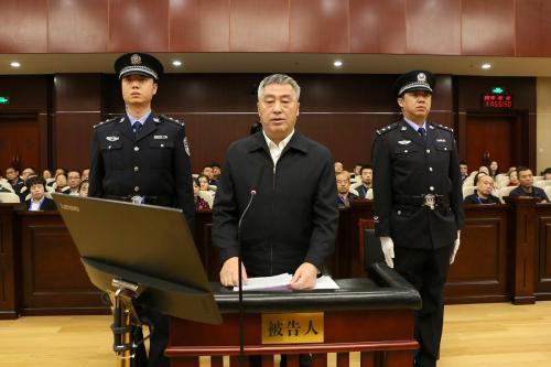 Former provincial legislator stands trial for bribery