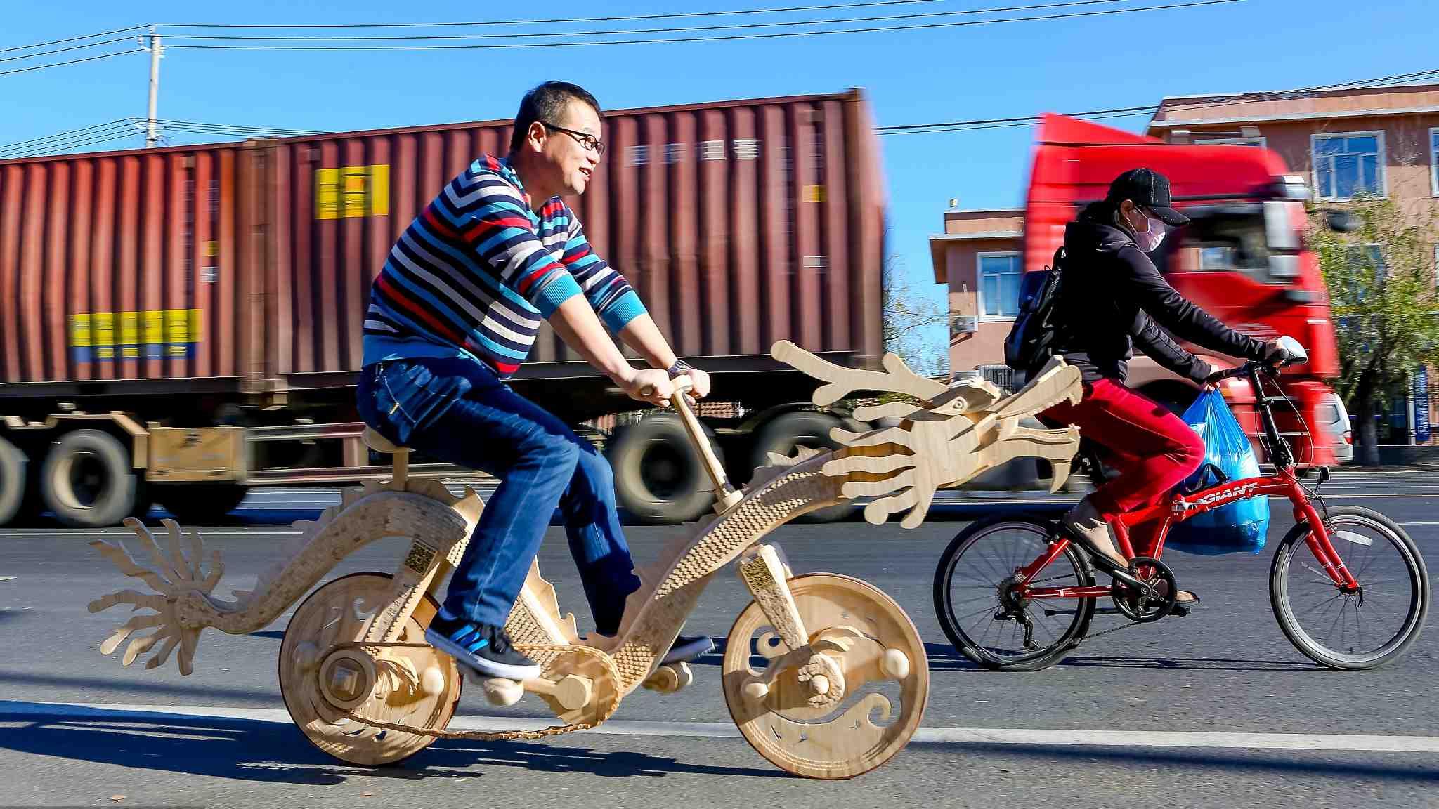 Welder creates wooden bike with ice cream sticks