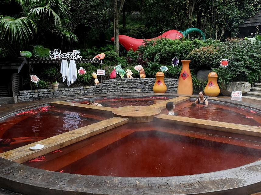 Visitors relax in a hot pot-style hot spring in Chongqing