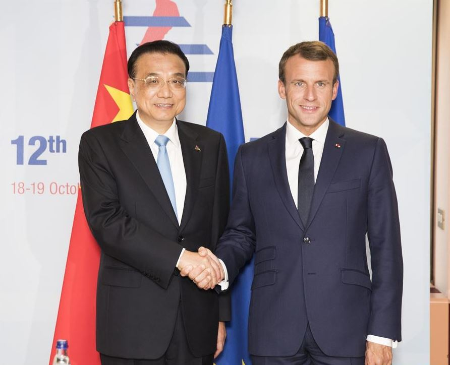 China to further expand two-way opening-up with France, premier says