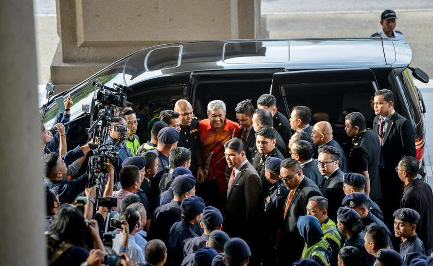 Former Malaysian deputy PM Zahid charged with corruption, money laundering