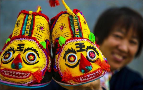 Tiger-head shoes making helps rural women increase income in Wugong, China's Hebei