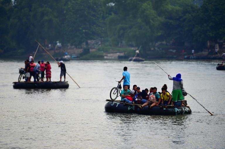 Mexico allows caravan women, children in, but thousands still stranded