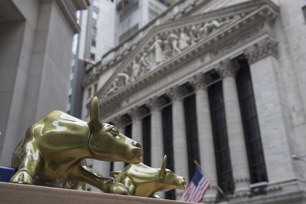 Stocks turn mostly lower at midday