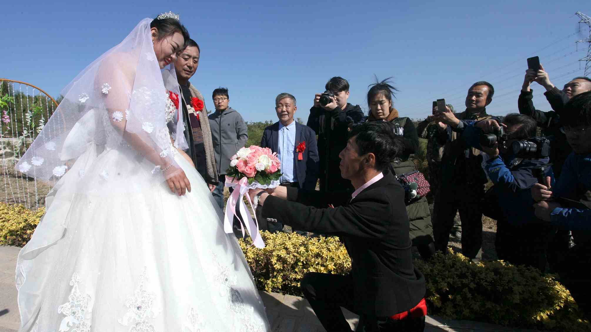 Till death do us part: Chinese couple tie the knot in a cemetery