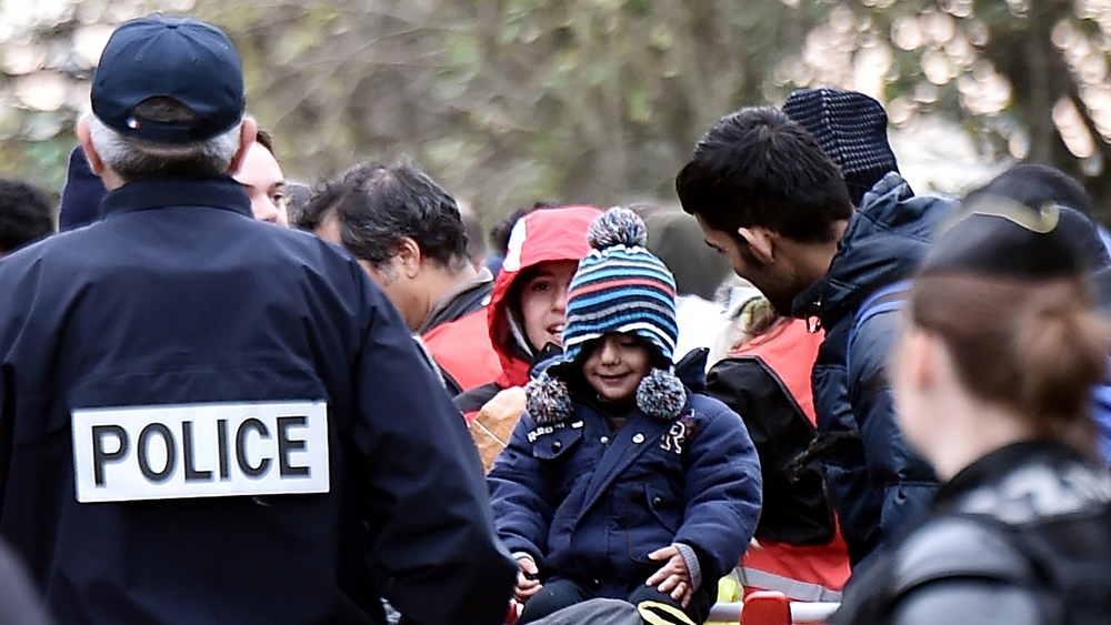 France clears 1,800 migrants from northern camp