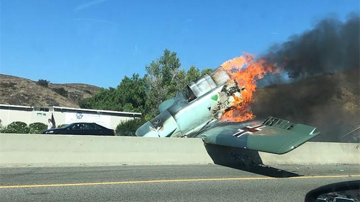 Vintage plane crash-lands on US freeway, no injuries
