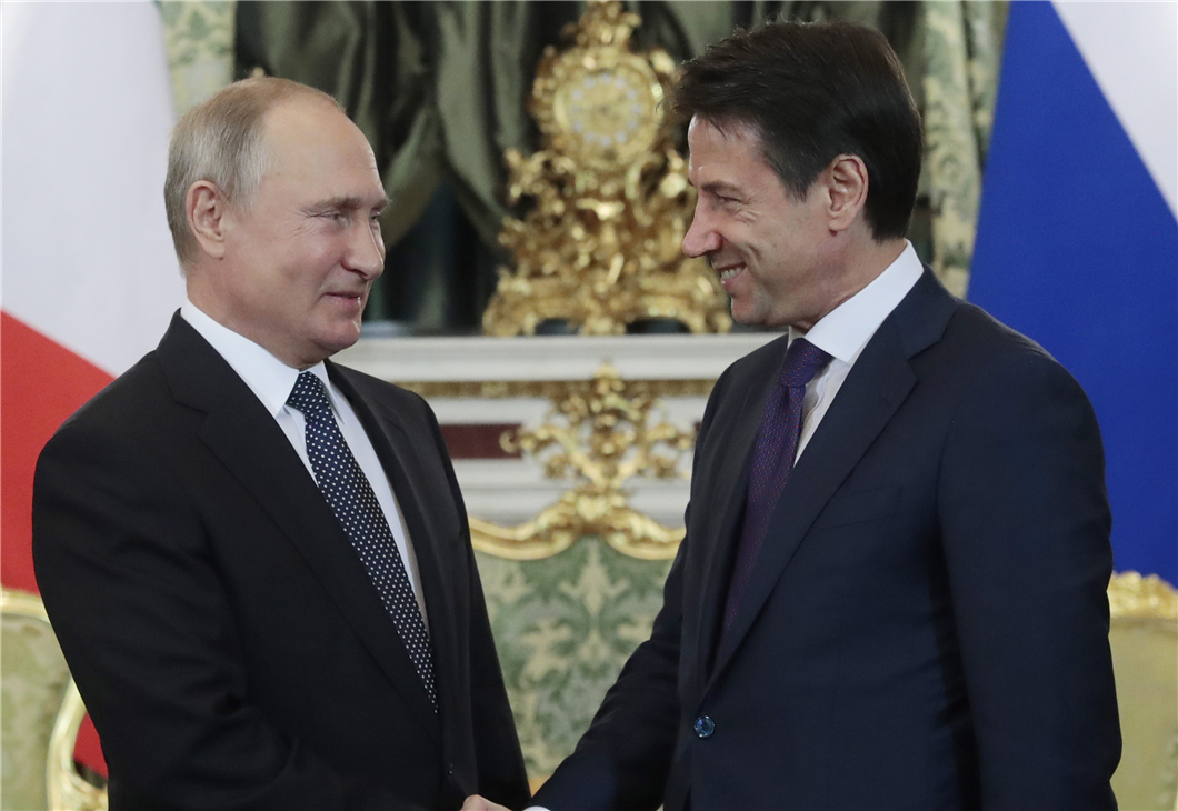 Italy's leader visits Russia for talks with Putin on trade