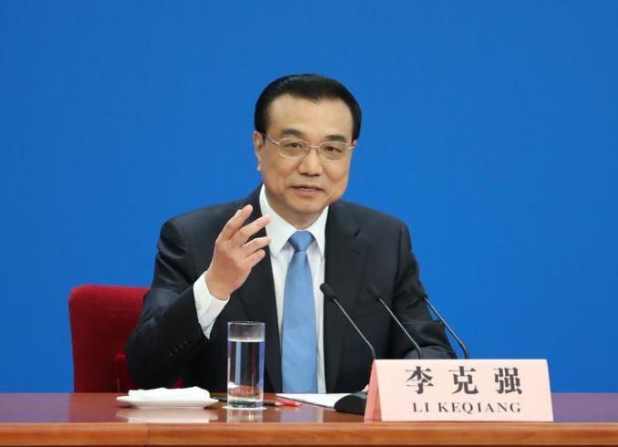 Premier Li vows to brave challenges, bolster economy